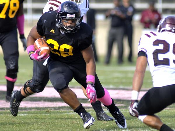 Grambling running back Jestin Kelly (28) searches for running room against Texas Southern in the first half of an NCAA college football game in Grambling, La., Saturday, Oct. 26, 2013. (Kita Wright/AP)