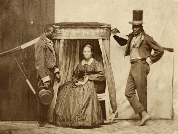 A lady with two slaves, in Bahia, Brazil, 1860.