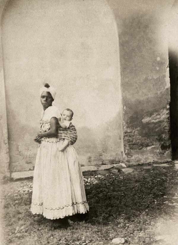 Black woman with white child on her back. Bahia, 1860.