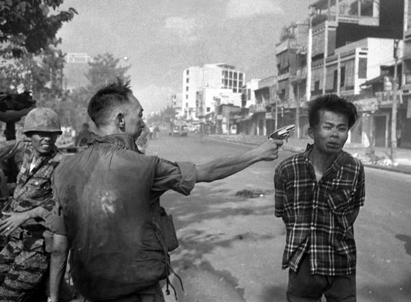 """Gen. Nguyen Ngoc Loan, South Vietnamese chief of the national police, fires his pistol into the head of suspected Viet Cong official Nguyen Van Lem on a Saigon street early in the Tet Offensive, February 1, 1968. Photographer Eddie Adams reported that after the shooting, Loan approached him and said, """"They killed many of my people, and yours too,"""" then walked away. (Eddie Adams/AP) 1969 Pulitzer Prize winner for Spot News Photography"""