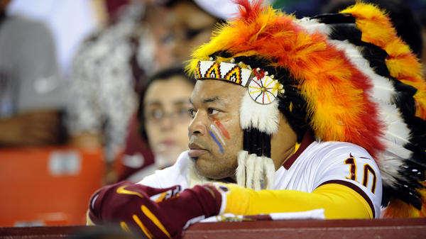 A Washington Redskins fan watches the game in Landover, Md.