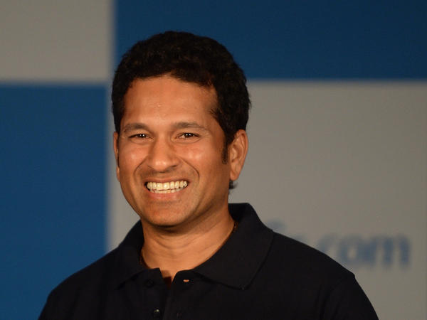 Sachin Tendulkar smiles during a news conference in Mumbai on Oct. 23. The beloved batsman was one of cricket's first millionaires.