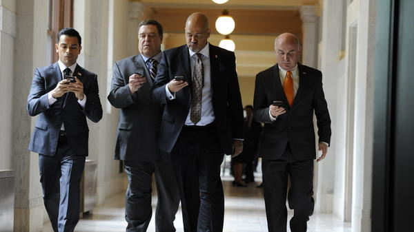 Mark Consuelos (from left), John Goodman, Clark Johnson and Matt Malloy star as four Republican senators sharing a house in Washington in <em>Alpha House, </em>Amazon's first original series.