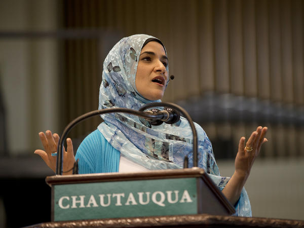 Dalia Mogahed delivers a speech after being coached by comedian and author Judy Carter.