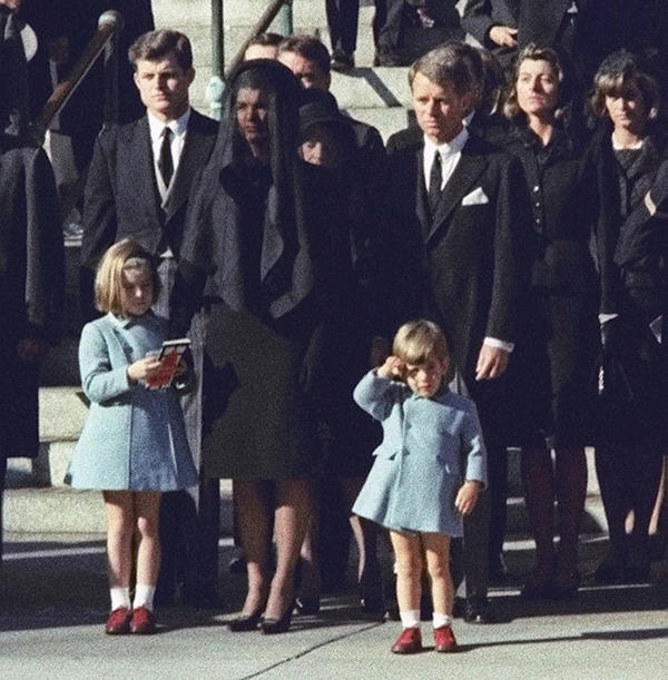 Three-year-old John F. Kennedy Jr. salutes his father's coffin in Washington. Mrs. Kennedy and daughter Caroline are accompanied by the late president's brothers Edward Kennedy (left) and Attorney General Robert Kennedy.