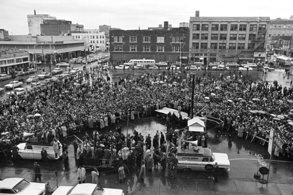 Kennedy addresses a rain-soaked crowd in Fort Worth shortly before attending a breakfast with the Fort Worth Chamber of Commerce at the Hotel Texas.