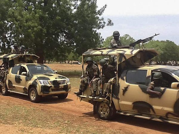 Nigerian soldiers arrive in Yola, Nigeria, on May 20, following the declaration of a state of emergency there and in two other states.