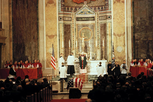 The funeral mass for President Kennedy is held in St. Matthew's Cathedral in Washington, D.C. About 1,200 invited guests attended the service led by the Archbishop of Boston, Cardinal Richard Cushing.