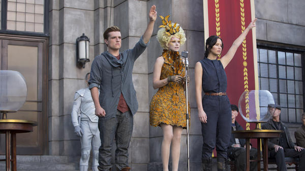Effie Trinket taps Katniss Everdeen (Jennifer Lawrence, right) and Peeta Mellark (Josh Hutcherson) for the Hunger Games arena again — but this time the rules are different and the stakes are higher as rebellion brews in Panem.