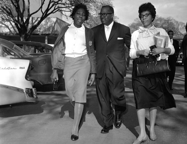 The Rev. T.J. Jemison escorts Mary Briscoe (left) and Sandra Ann Jones from jail in Baton Rouge, La., on April 4, 1960. The two had been in jail as a result of lunch counter sit-ins.