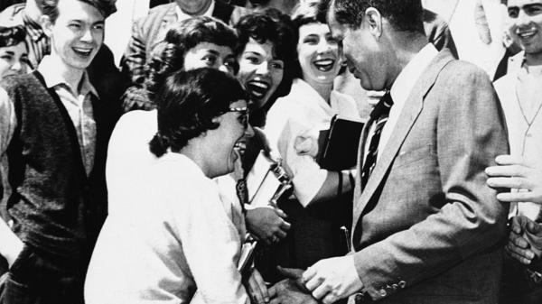 Then-Sen. John F. Kennedy showed some of the charisma that powered his presidential bid as he greeted college students in Charleston, W.Va., in April 1960.