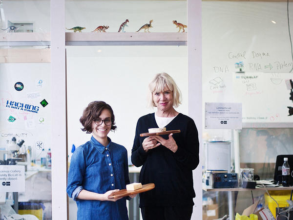 Microbiologist Christina Agapakis (left) and artist Sissel Tolaas show off the cheese they made with bacteria from human skin. The project was part of Agapakis' graduate thesis at Harvard University.