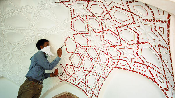 Artisans replicated the original patterns and designs on the monument's ceiling using the same dyes and tools that were used in the 16th century.
