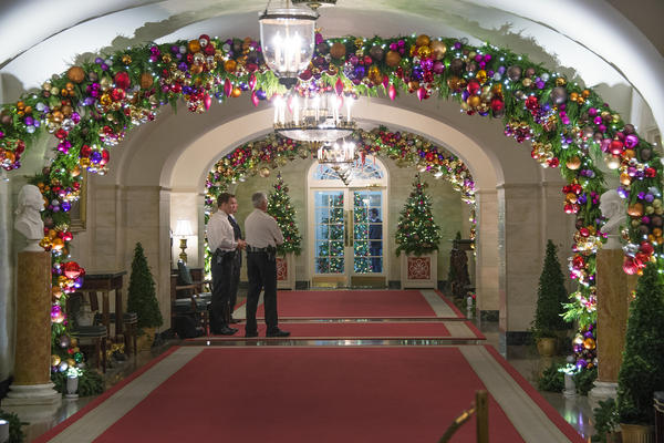 The hallway off the China Room drips with holiday cheer.