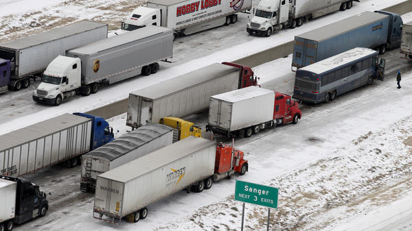 Tractor trailers sit on I-35 north of Dallas on Saturday.