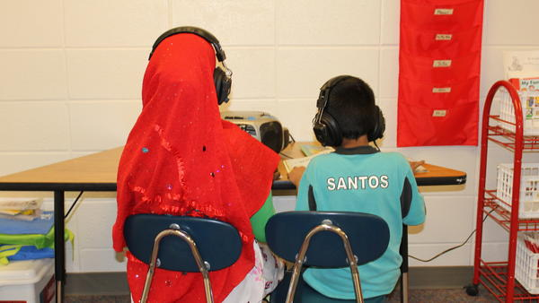 """Two students in a """"newcomer"""" class at Florence Wilson Elementary School in Garden City — a Somali girl (left), and a Hispanic boy."""