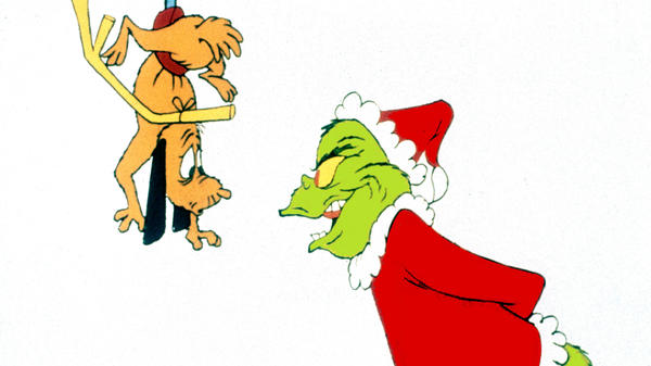 The Grinch puts a scare into his dog, Max, in the 1966 CBS special <em>How The Grinch Stole Christmas</em>.