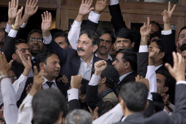 Chief Justice Iftikhar Chaudhry (center) is greeted by lawyers in Islamabad after the government announced it would reinstate him, in March 2009. Pakistan's longest-serving chief justice challenged the status quo and fought to chart a more assertive and independent course for the country's judiciary.