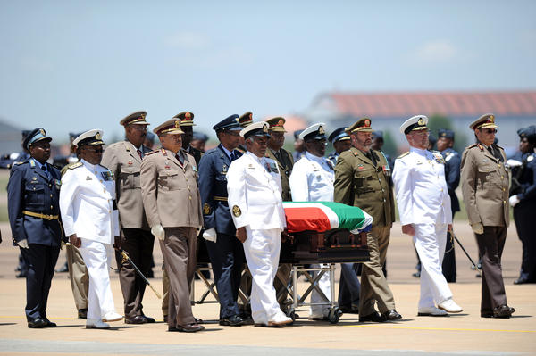 Officers guard Mandela's coffin after the Farewell Service on Saturday.