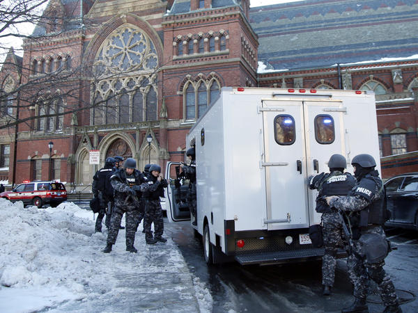 SWAT team officers on the scene Monday at Harvard University in Cambridge, Mass. Four buildings on campus were evacuated after an unconfirmed report that explosives may have been placed inside.