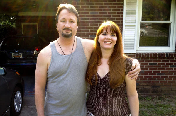 Michael Hartnett was a Marine during the Gulf War and served in Somalia. He received a bad conduct discharge for abusing drugs and alcohol. His wife, Molly, helped him turn his life around. (Quil Lawrence/NPR)