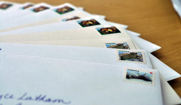 Canadian Stamps on mail. (Flооd/Flickr)