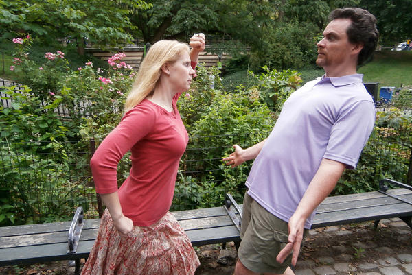 Tim and Tanya Chartier present a classic mime stance. They have found a way to teach math through miming. (Ari Daniel)