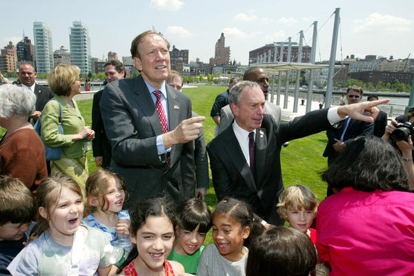 "Bloomberg and Pataki (left) tour the first completed section of Hudson River Park after opening ceremonies May 30, 2003, with children from nearby Public School 3. The 10-acre stretch of Manhattan parkland along the Hudson River is billed as ""the Central Park of the 21st century."""
