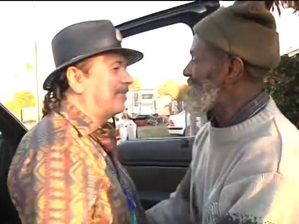 Carlos Santana, left, and Marcus Malone when they reunited in Oakland. Malone was part of Santana's band in the late '60s, then spent the past four decades or so living on the streets or in prison.