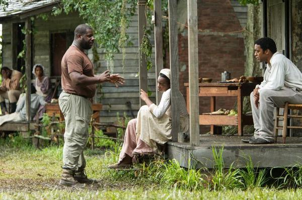 Director Steve McQueen works with his cast on the <em>12 Years a Slave</em> set.