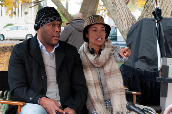 Writer-director Tina Gordon Chism sits on the set of <em>Peeples</em> with producer Tyler Perry, who also wrote and directed <em>Temptation</em> and <em>A Madea Christmas</em> this year.
