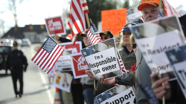 Supporters for gun rights gather outside the National Shooting Sports Foundation headquarters in Newtown, Conn., on March 28.