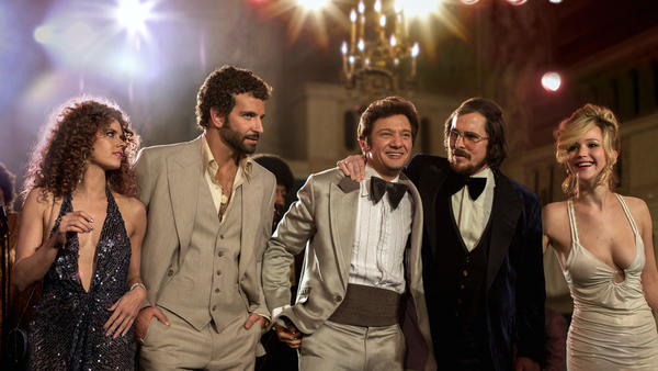 Amy Adams, Bradley Cooper, Jeremy Renner, Christian Bale and Jennifer Lawrence star in <em>American Hustle,</em> a movie loosely based on Abscam, an '80s-era public corruption scandal.