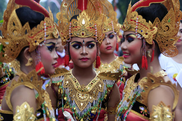 Balinese girls in traditional costumes gather during a parade for 2013's last sundown in Bali, Indonesia.