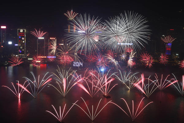New Year's Eve fireworks explode over Hong Kong's Victoria Harbor, marking the start of 2014 near the Convention and Exhibition Centre.