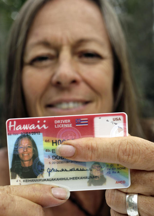 Janice Keihanaikukauakahihulihe'ekahaunaele holds her old Hawaii drivers license that lacked the space for her full name.