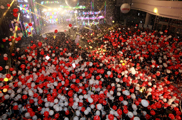 People celebrate the New Year during an event for the Count Down Seoul 2014 at the Time Square in Seoul, South Korea.