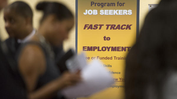 Job seekers line up to talk to recruiters during a job fair held in Atlanta in May.