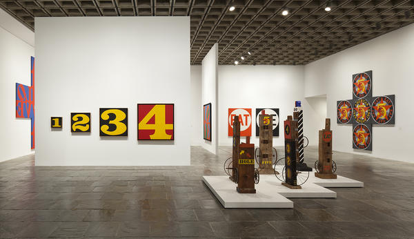 "The Whitney describes its retrospective as revealing ""an artist whose work, far from being unabashedly optimistic and affirmative, addresses the most fundamental issues facing humanity — love, death, sin and forgiveness."" [Left to right: <em>Exploding Numbers</em> (1964-66); <em>Hole</em> (1960); <em>Five</em> (1984).]"