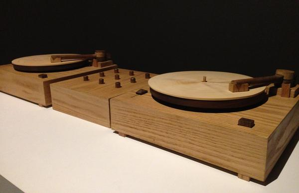 Two turntables carved from wood scratch out the sound of <em>Beat Nation</em> artist Jordan Bennett learning his native Mi'kmaq language.