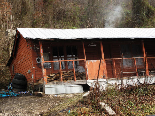 This is the Fletcher cabin today. It now has wood siding and is painted orange.