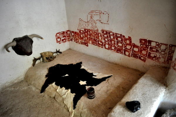 A reproduction of the mural from a room in Catalhoyuk, a Neolithic settlement in Turkey.