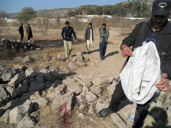 Pakistani security personnel examine the site of a suicide bombing in the Ibrahimzai area of Hangu, Pakistan, on Monday. The bombing killed 15-year-old Aitizaz Hasan, who prevented the bomber from attacking a school.