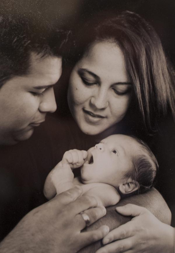 Erick and Marlise Munoz are pictured with their first child, Mateo, who is now 15 months old. (Courtesy of the family)