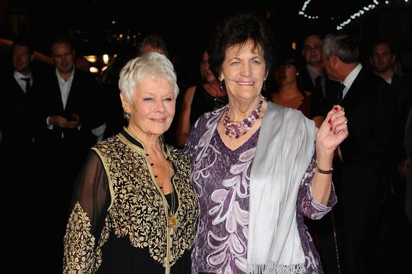 Actress Dame Judi Dench and Philomena Lee attend the 'Philomena' American Express Gala screening during the 57th BFI London Film Festival at Odeon Leicester Square on October 16, 2013 in London, England. (Zak Hussein/Getty Images for BFI)