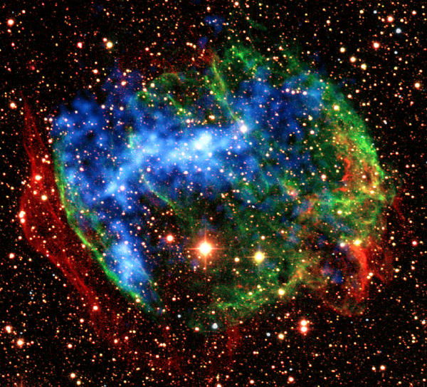 This image provided by NASA Wednesday Dec. 30, 2009 shows a view combining infrared images from the ground (red, green) with X-ray data from NASA's Chandra X-Ray Observatory in the supernova remnant W49B. Studies of two supernova remnants using the Japan-U.S. Suzaku observatory have revealed never-before-seen embers of the high-temperature fireballs that immediately followed the explosions. Even after thousands of years, gas within these stellar wrecks retain the imprint of temperatures 10,000 times hotter than the sun's surface. Suzaku found another fossil fireball. It detected X-rays produced when heavily ionized iron atoms recapture an electron. (AP Photo/NASA)
