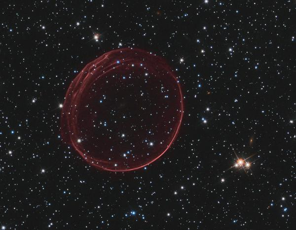 A delicate sphere of gas, photographed by NASA's Hubble Space Telescope, floats serenely in the depths of space. The pristine shell, or bubble, is the result of gas that is being shocked by the expanding blast wave from a supernova. Called SNR 0509-67.5 (or SNR 0509 for short), the bubble is the visible remnant of a powerful stellar explosion in the Large Magellanic Cloud (LMC), a small galaxy about 160,000 light-years from Earth.