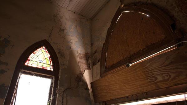 Windows are boarded up inside Centennial Baptist Church.