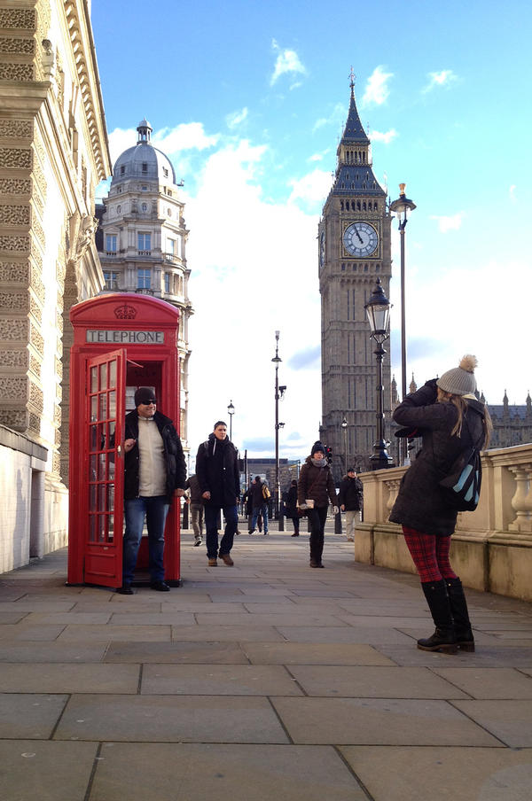 "The most photographed phone booth in London sits in front of Big Ben. The number of beloved crimson ""telephone boxes"" in the United Kingdom has fallen sharply in recent years, from 92,000 in 2002 to just 48,000 now."