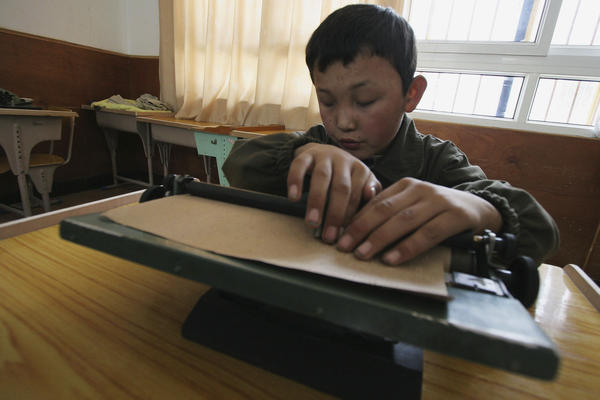A blind child studies at the Braille Without Borders school  in Lhasa, Tibet, in 2005. The program was the first of its kind in the country.